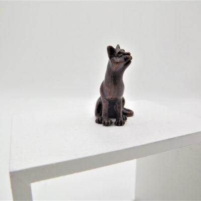 Miniature Sitting Cat